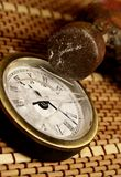 Kill the time. Damaged clock with an old hammer Stock Photos