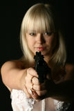 Kill you. Bride in white dress with pistol wants to kill you Stock Photo
