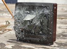 Kill Your Television. An old tube television exploding from a sledge hammer blow Stock Photo
