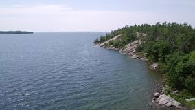 Killbear provincial park. Aerial view of the Georgian bay. Flying with drone above the Georgian bay of Huron lake stock footage