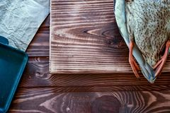 Killed duck before cooking. Killed duck lies on a wooden background. Hunting season. Top view. Cooking time royalty free stock photography