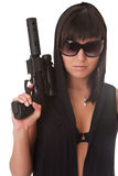 Killer. Woman with a gun in a hand isolated on a white background Stock Photos