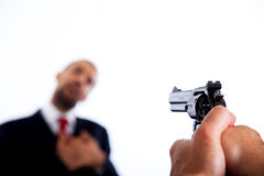 Killer aiming on Businessman Stock Image