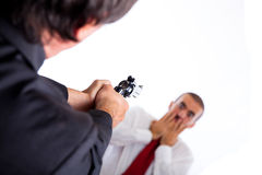 Killer aiming on Businessman Stock Photography