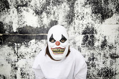 Killer clown. Crazy clown mask halloween costume and fear stock photography