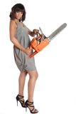 Killer date chainsaw lady. An African-American or Multiracial brunette is dressed to kill and she is holding a chainsaw to punctuate the fact royalty free stock photo