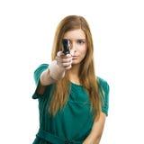 Killer girl. Beautiful woman holding a weapon stock photos