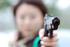 Killer with a gun Royalty Free Stock Photos