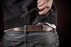 Killer with gun close-up Royalty Free Stock Photography