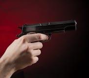 Killer with gun close-up Stock Photo
