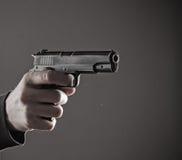 Killer with gun close-up Royalty Free Stock Photo