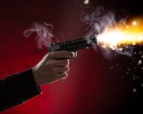 Killer with gun close-up Stock Photography