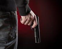 Killer with gun close-up Stock Image