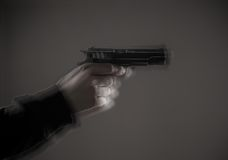 Killer with gun close-up Royalty Free Stock Images