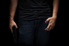 Killer with gun close up over black background. A Killer with gun close up over black background Stock Photos