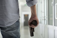 Killer with a gun in the hallway. People criminal concept - killer with a gun in the hallway royalty free stock images