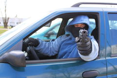 Killer headed out of the car Royalty Free Stock Image
