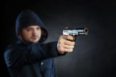 Killer holding gun Stock Photo