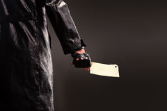 Killer holding meat cleaver in hand. Royalty Free Stock Photos