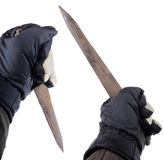 Killer instincts. Gloved hands holding sharp sword over white background Stock Photography