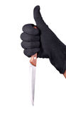 Killer knife. Hand holding a knife on isolated background with clipping path Stock Images