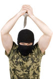 The killer with a knife in a black mask Stock Photo