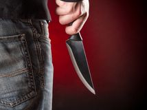 Killer with knife close-up Stock Images
