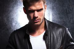 Killer look of a young macho man. In leather jacket Royalty Free Stock Images