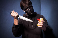 Killer with mask Royalty Free Stock Photos