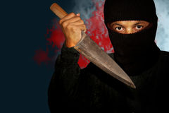 A killer person with sharp. Evil criminal with large sharp knife ready for robbery or to commit a homicide royalty free stock photography