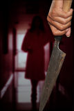 A killer person with sharp. Evil criminal with large sharp knife ready for robbery or to commit a homicide royalty free stock images