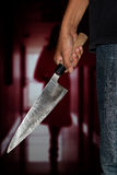 A killer person with sharp. Evil criminal with large sharp knife ready for robbery or to commit a homicide stock images