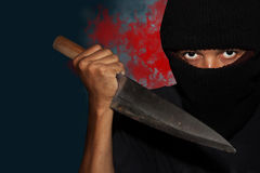 A killer person with sharp. Evil criminal with large sharp knife ready for robbery or to commit a homicide royalty free stock photos