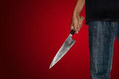 A killer person with sharp. Evil criminal with large sharp knife ready for robbery or to commit a homicide with clipping path stock image