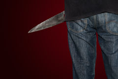 A killer person with sharp. Evil criminal with large sharp knife ready for robbery or to commit a homicide with clipping path royalty free stock photos