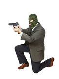Killer shooting with a gun and standing on his knee Royalty Free Stock Photo