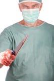 Killer Surgeon. A 60 year old surgeon holding a bloody nice. Malpractice concept Stock Photos