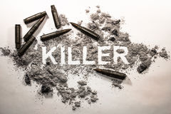 Killer text word written in grey ash, dirt, filth with bullets a Stock Photos