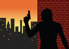 Killer vector silhouette. Vector silhouette of armed man at urban city Stock Photo