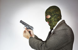 Killer wearing mask with a gun Royalty Free Stock Photo