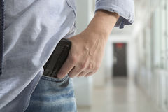 Killer With A Gun In The Hallway Stock Photography
