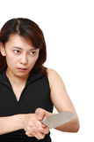 Killer woman with knife. Studio shot of young asian woman on white background Royalty Free Stock Photos