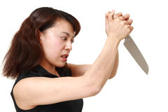 Killer woman with knife. Studio shot of young asian woman on white background Royalty Free Stock Photography