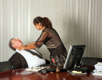 Killing the boss. Frustrated assistant committing murder by strangling her boss Royalty Free Stock Photography
