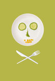 Killing diet. A plate with vegetables, knife and fork in the shape of skull and bones Stock Photo