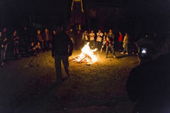 Killing fears. Young teenagers throwing in fire their fears. Photo taken at a party stock photography