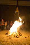 Killing fears. Young teenagers throwing in fire their fears. Photo taken at a party royalty free stock image