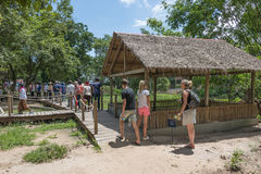 Killing fields, Cambodia. Tourists at the Killing Fields in Choeung Ek, one of the places where Pol Pots followers slaughtered thousands of people , burying them Royalty Free Stock Photos