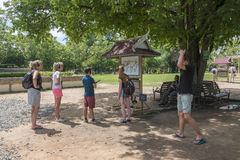 Killing fields, Cambodia. Tourists with headsets at the guided tour at the Killing Fields in Choeung Ek, one of the places where Pol Pots followers slaughtered Royalty Free Stock Images
