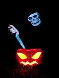Killing jack-o-lantern. Spooky skull killing jack-o-lantern Royalty Free Stock Photography